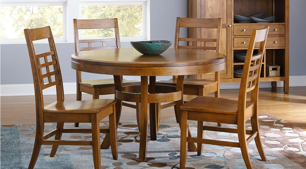 Solid wood round dining table with four matching chairs
